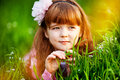 Little girl in a beautiful dress lush garden Stock Photos