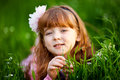 Little girl in a beautiful dress lush garden Stock Photography