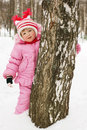 Little girl  behind a tree Royalty Free Stock Image
