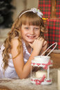 Little girl being happy about christmas present story Royalty Free Stock Photo