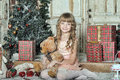 Little girl being happy about christmas present story Royalty Free Stock Photography