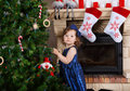 Little girl being happy about christmas tree and lights Royalty Free Stock Photos