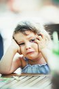 Little girl being sad cute thinking Royalty Free Stock Image