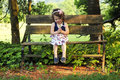 Little Girl on Bench Stock Image
