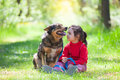 Little girl with big dog in the forest happy sitting lawn Royalty Free Stock Images