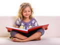 Little girl big red book Royalty Free Stock Photo
