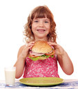 Little girl with big sandwich Stock Photos