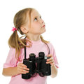 Little girl with binoculars Stock Photos