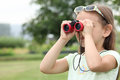 Little girl with binoculars looking through Royalty Free Stock Photography