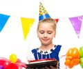 Little girl birthday cake happy holding gift box Royalty Free Stock Photo