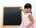 Little girl with black board asian white chalk in front of Stock Images