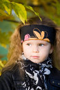Little girl in a black leather jacket and bandana Royalty Free Stock Photography