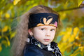 Little girl in a black leather jacket and bandana Royalty Free Stock Images
