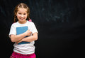 Little girl  on black school board background Royalty Free Stock Photo