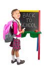 Little girl at a blackboard schoolgirl standing next to the with the back to school message on it isolated Royalty Free Stock Photo