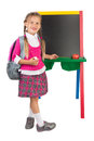 Little girl at a blackboard schoolgirl standing next to the blank isolated Stock Photo