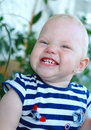 Little girl with blond hair smiling and grimacing Stock Images