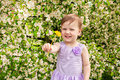 Little girl with blossoming bush and dandelion the beautiful tree Stock Photo
