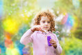 A little girl blowing bubbles soap Royalty Free Stock Photography