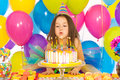 Little girl blowing candles on birthday cake Royalty Free Stock Photo