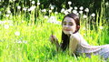 Little girl blowing dandelions on a meadow Royalty Free Stock Photos