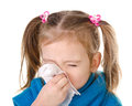 Little girl blowing her nose in a great effort closeup isolated Stock Images
