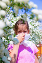 Little girl is blowing her nose pollen allergy Royalty Free Stock Images