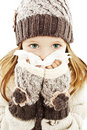 Little girl blowing her nose. Winter style. Royalty Free Stock Photography