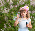 Little girl blowing soap bubbles Royalty Free Stock Image