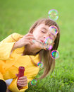 Little girl blowing soap bubbles portrait of cute Stock Photos