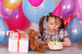 Little girl blows out the candles Royalty Free Stock Images