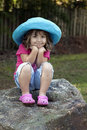Little girl in blue hat Royalty Free Stock Photo