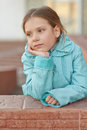 Little girl in blue jacket beautiful around school building Royalty Free Stock Photos