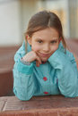 Little girl in blue jacket beautiful around school building Stock Photography