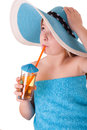 Little girl in blue summer hat drinking juice beautiful Royalty Free Stock Photos