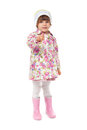 Little girl in boots and a jacket shows finger Stock Photography