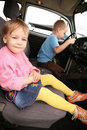 Little Girl and boy in car Stock Photos