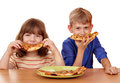 Little girl and boy eat pizza Royalty Free Stock Photo