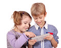 Little girl and boy fun with tablet pc Stock Photos