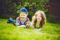Little girl and boy lying on the green grass and smiling Royalty Free Stock Photos