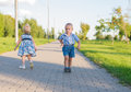 Little girl and boy runs away from the quarrel Royalty Free Stock Photo