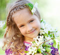 Little girl with branches blossoming apple tree Royalty Free Stock Images