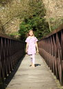 Little girl on bridge Royalty Free Stock Photo