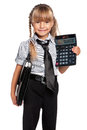 Little girl with briefcase in school uniform and calculator isolated on white background Royalty Free Stock Photos