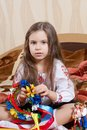 Little girl with a bright wreath adorable sitting cross legged Stock Photo
