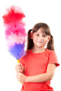 Little girl with a broom to clean the dust Stock Photo