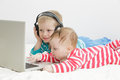 Little girl with brother looking at laptop Royalty Free Stock Photo