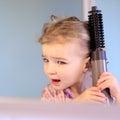 Little girl brushing her hair Royalty Free Stock Photo