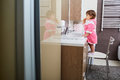 Little girl brushing her teeth in the bathroom Royalty Free Stock Photo