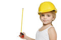 Little girl builder using a measuring tape Stock Image